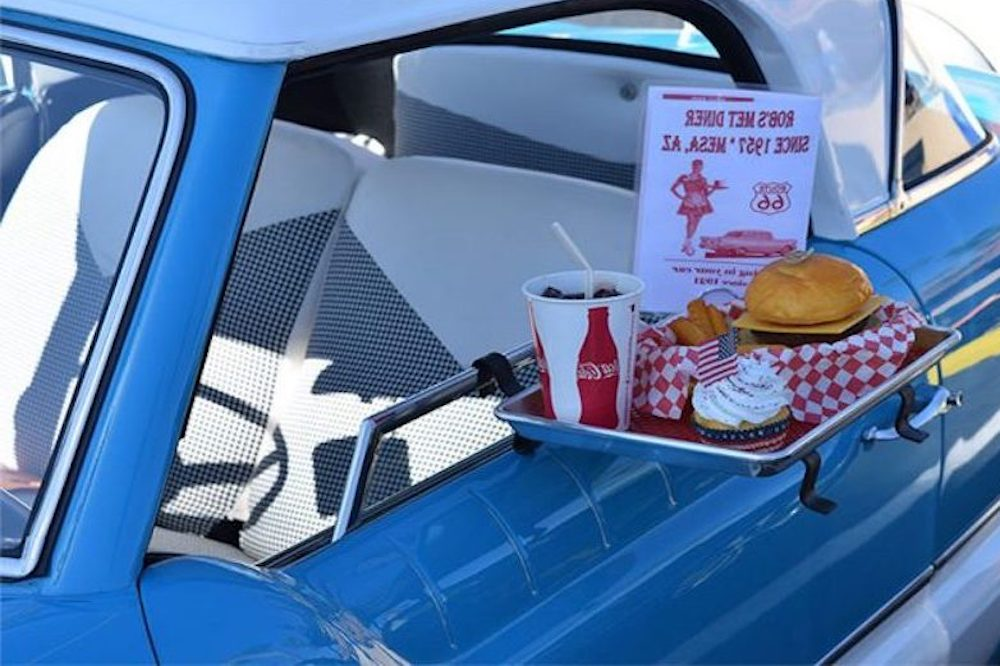 cornflower blue retro car with food tray on door serving burger fries and soda